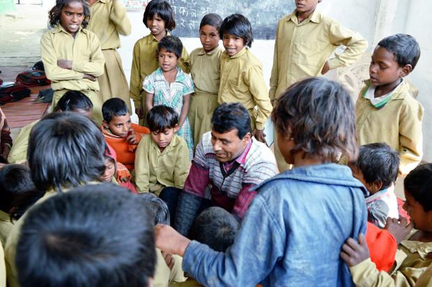 Harikesh Bahadur with his students at the school at Deva Nandpur village in Raebareli