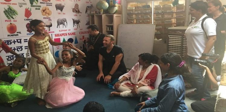 Chris Martin visits education project of Oxfam India in Delhi
