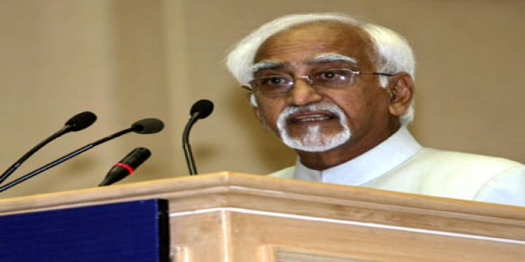 Hamid Ansari speaking on a podium