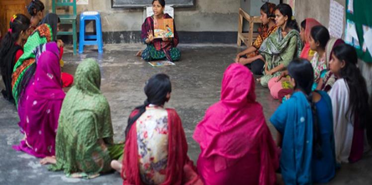 Women sitting on the floor having a discussion