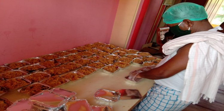 food packets being prepared for distribution
