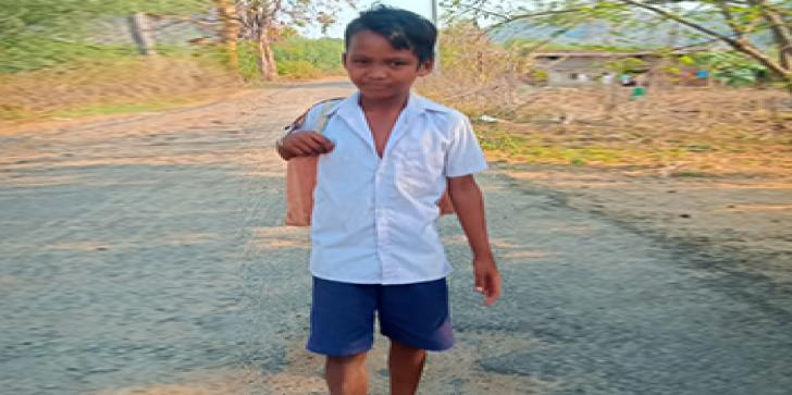 Ajay, a class four student, who was supported by Oxfam India